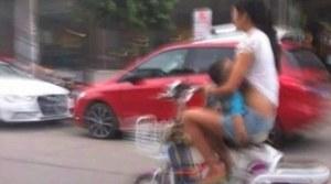breastfeeding mama on moped